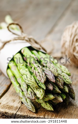asparagus on a dark wood background. the toning. selective focus - stock photo