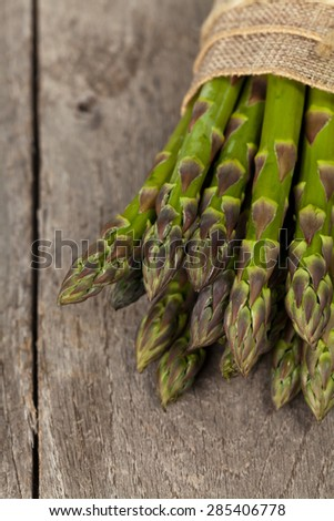 Asparagus on a rustic wooden background. Selective focus.