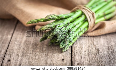 Asparagus on wooden table - stock photo