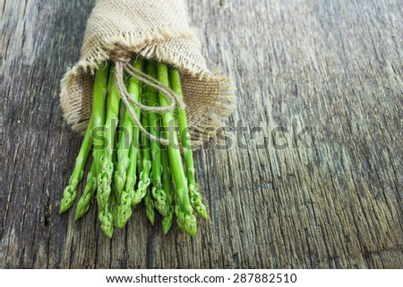 Asparagus on wooden table, rustic style