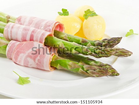 asparagus served with ham.Selective focus