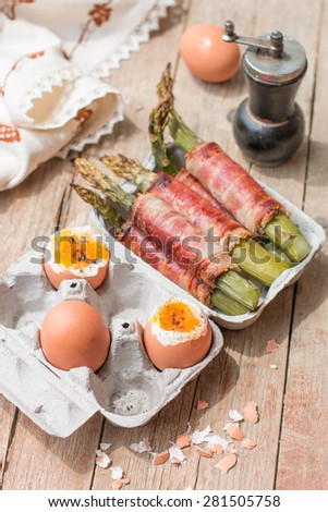 Asparagus with becon and soft-boiled egg - stock photo