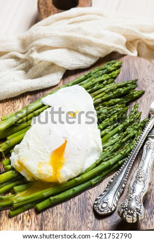 Asparagus with poached egg - stock photo