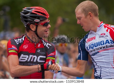 ASPEN, CO - AUG 23: Cadel Evans (left) shaking hands with Tim Duggan at the US Pro Cycling Challenge in Aspen, CO on Aug 23, 2012
