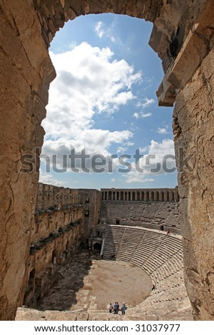 Aspendos theater through an arch - stock photo