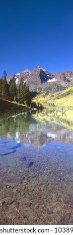 Aspens and morning light, Maroon Bells near Aspen, Colorado - stock photo