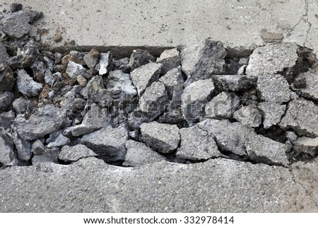 Asphalt after demolishing with jackhammer tool at construction site - stock photo