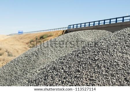 Asphalt and asphalting the road. Close up - stock photo
