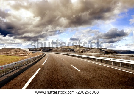 Asphalt and travel concept.Road and sunset. - stock photo