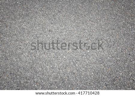 Asphalt concrete roadway pavement surface. Grey background. - stock photo