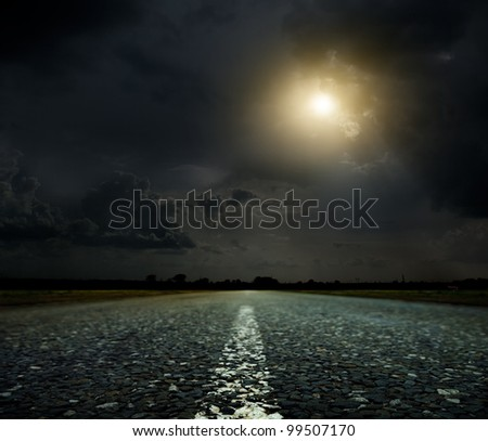 Asphalt country road at sunset - stock photo