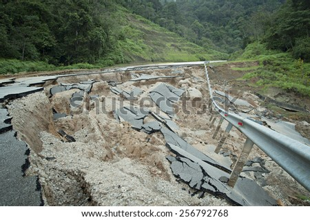 Asphalt Cracked Road Collapsed by natural disaster  - stock photo