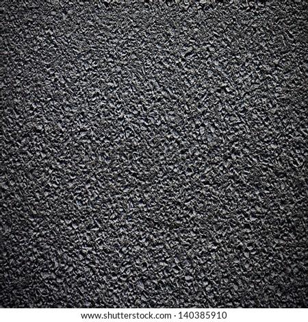Asphalt grainy surface on road - stock photo