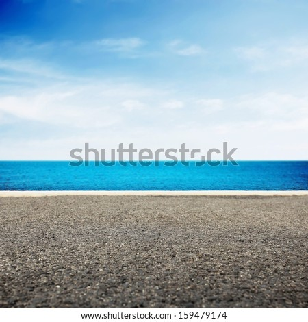 Asphalt path near the beautiful sea - stock photo