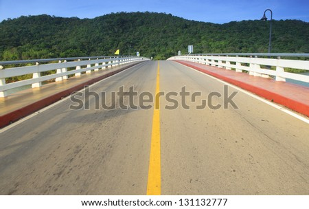 Asphalt road and mountain with blue sky
