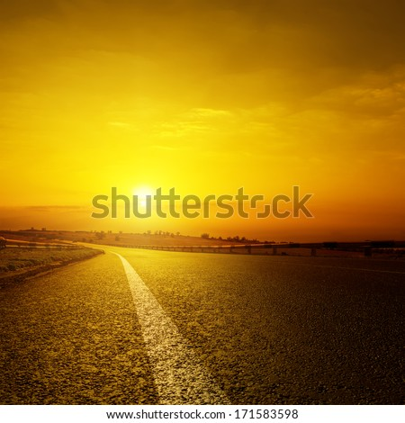 asphalt road and orange sunset - stock photo