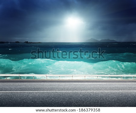 asphalt road and sea  - stock photo