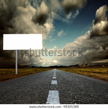 Asphalt road and sky. Shallow depth of field - stock photo