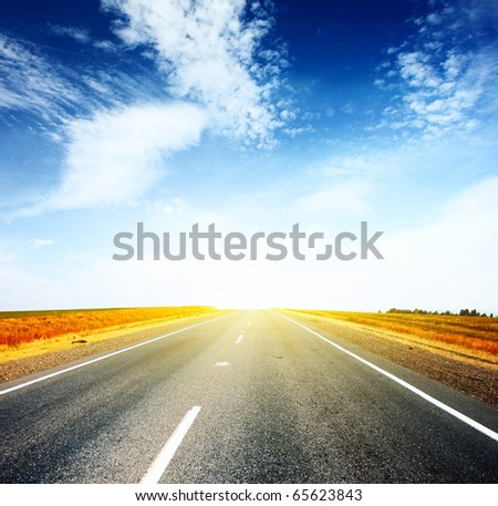 Asphalt road and sky with clouds
