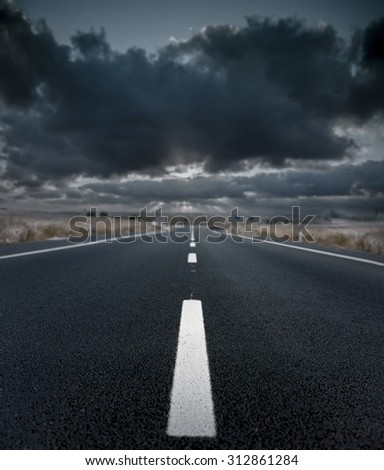 Asphalt road and the storm