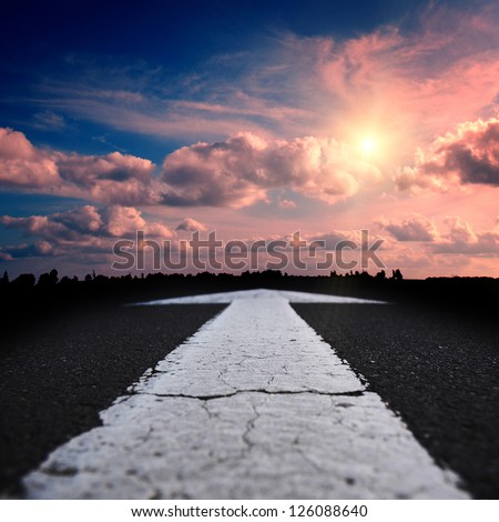 asphalt road at the red sunset - stock photo