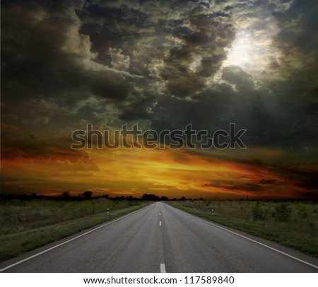 Asphalt road between fields trees - stock photo