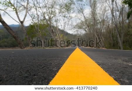 asphalt road, Blurred Yellow line on the asphalt road,asphalt road  in summer day  - stock photo