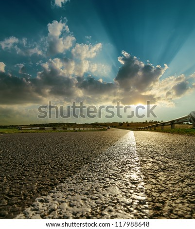 asphalt road closeup to sunset - stock photo