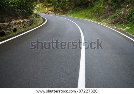 asphalt road curve with curve to the left