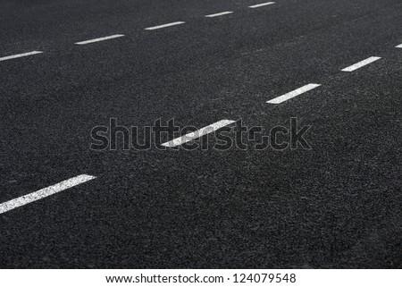 Asphalt road, detail of new traffic road. - stock photo