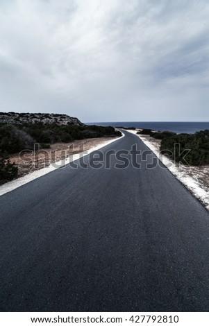Asphalt road  / Highland road / Asphalt road High way Empty curved road clouds - stock photo