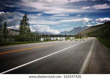 Asphalt road in Canada with mountains