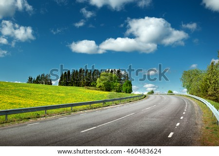 asphalt road in countryside on sunny spring day