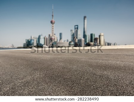 Asphalt road in front of the modern city Shanghai china - stock photo