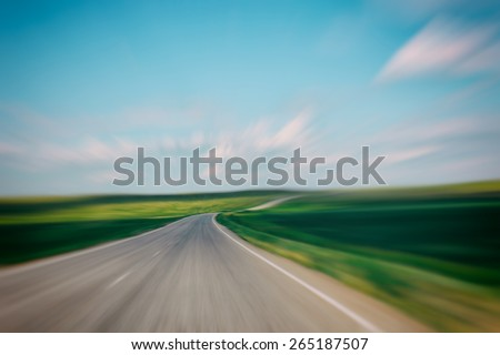 Asphalt road in motion, green and blue landscape, road background, road in future, field