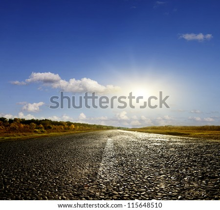Asphalt road in the autumn sunny day - stock photo