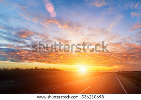 Asphalt road in the countryside at sunset or sunrise