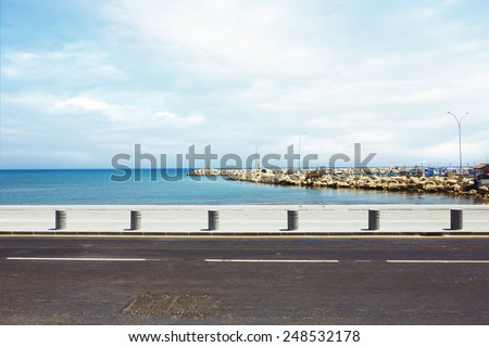 Asphalt road near the port and sea promenade  - stock photo
