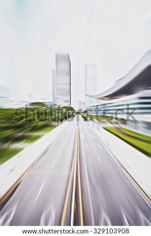 asphalt road of a modern city with skyscrapers as background - stock photo