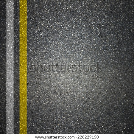 Asphalt Road Texture with White and Yellow Strips - stock photo