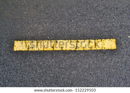 asphalt road texture with yellow stripe.
