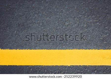 Asphalt road texture with yellow stripe - stock photo