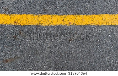Asphalt road texture with yellow stripe can be used as background - stock photo