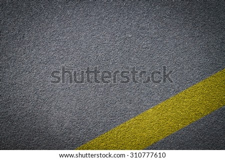 Asphalt road texture,yellow line on road