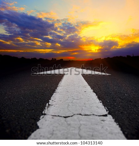 asphalt road through the fields at sunset - stock photo