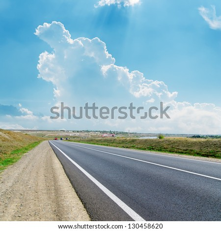 asphalt road to cloudy horizon