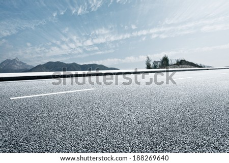 asphalt road to horizon  - stock photo