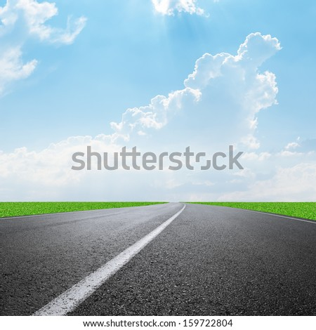 asphalt road to horizon and clouds on sky - stock photo