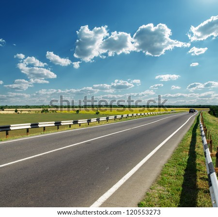 asphalt road to horizon in cloudy sky