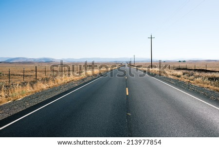 Asphalt Road to Infinity in California  - stock photo